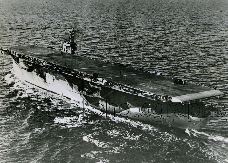 HMS BATTLER. - The pocket carrier HMS Battler from above.